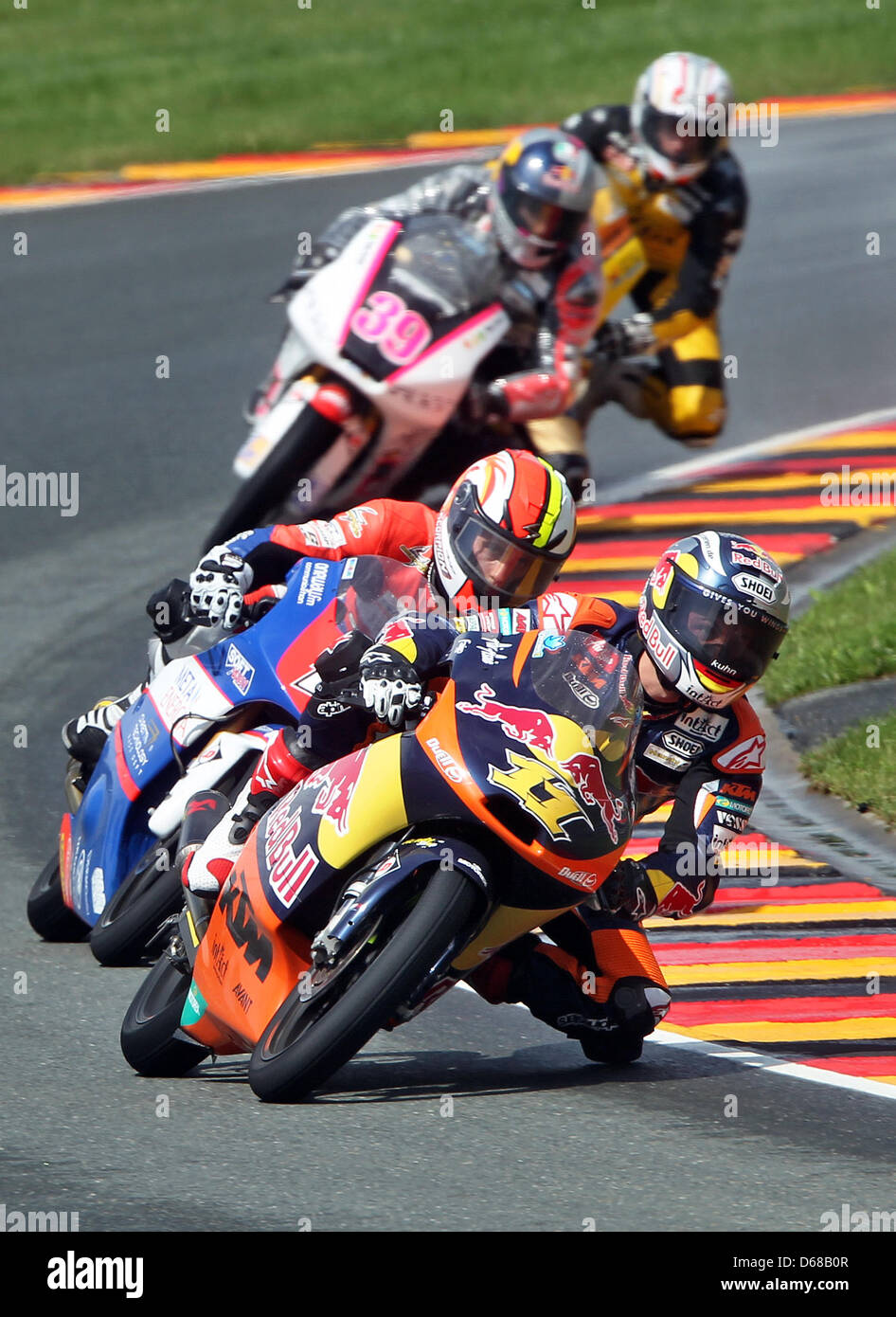 German rider Sandro Cortese of Team Red Bull KTM leads the field ahead of French MotoGP rider Alexis Masbou of Team - Stock Image