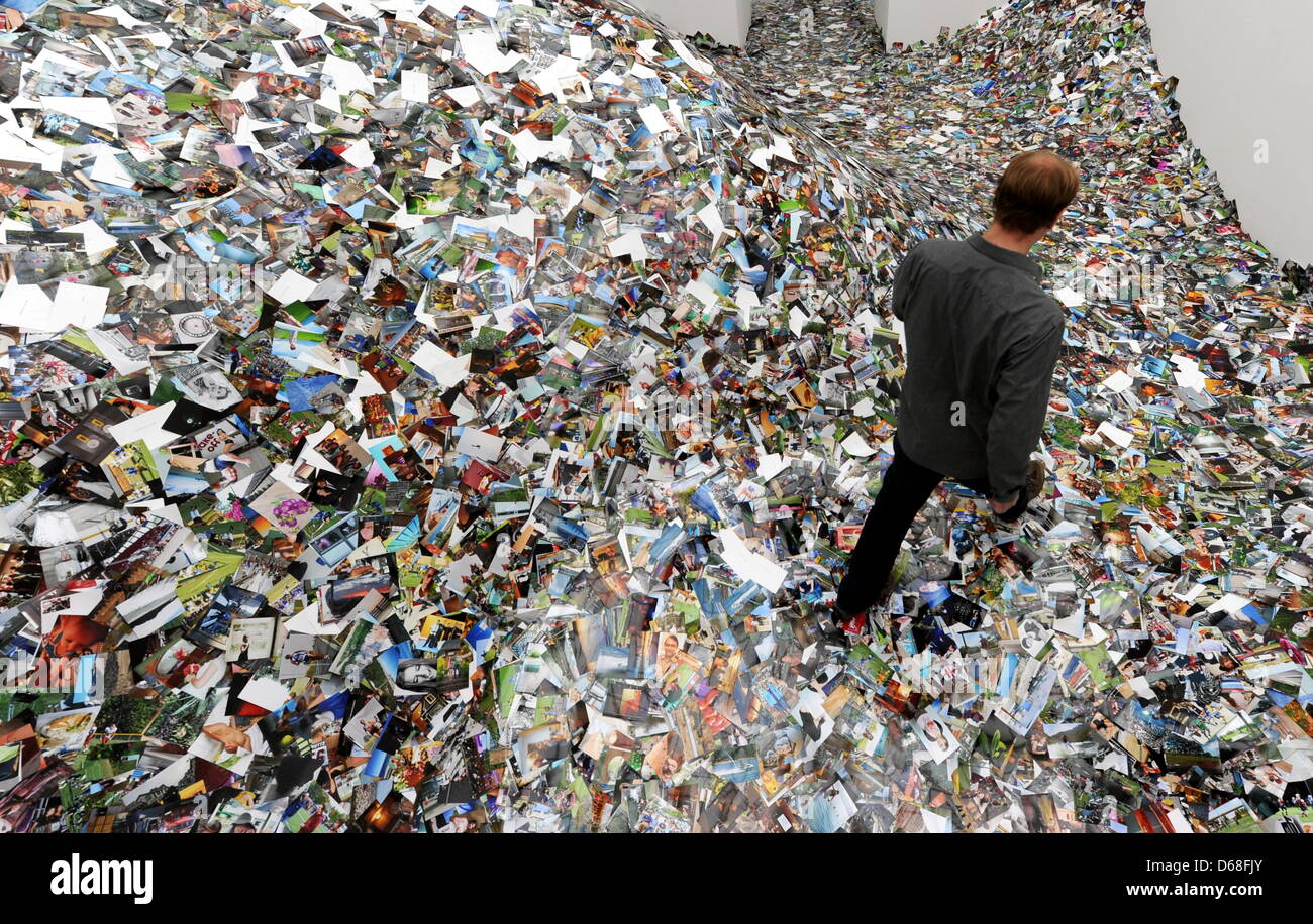 A visitor walks through an installation of Dutch artist Erik Kessels ...