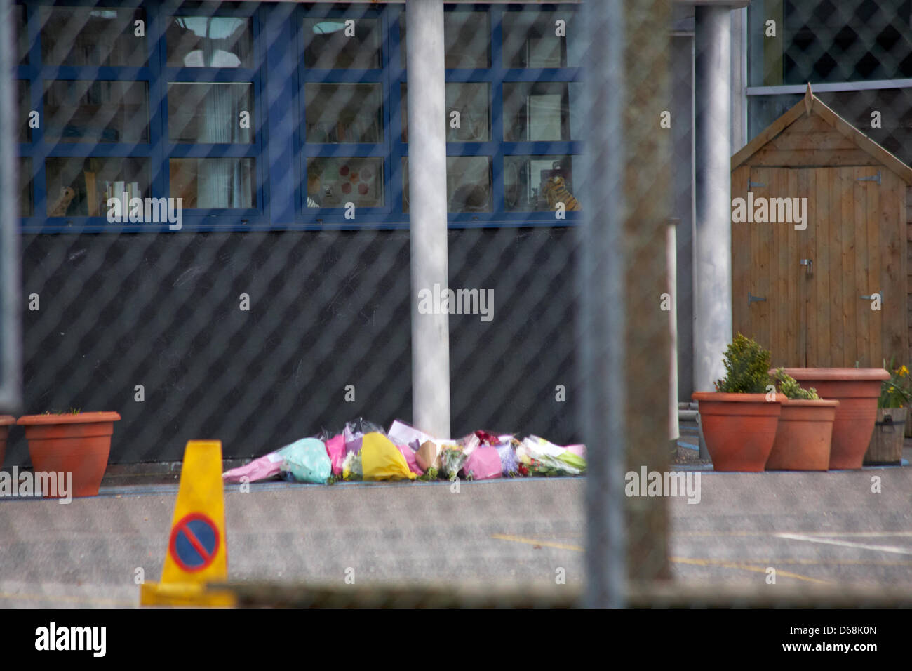 Parkstone, Poole, Dorset, UK Monday 15 April 2013. Pupils and teachers lay tributes following the tragic death of - Stock Image