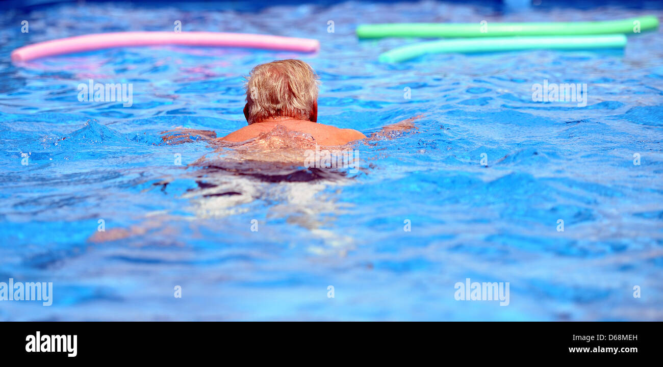 A man swims in the pool at the Zollverein Coal Mine Industrial Complex in Essen, Germany, 18 July 2012. The open - Stock Image