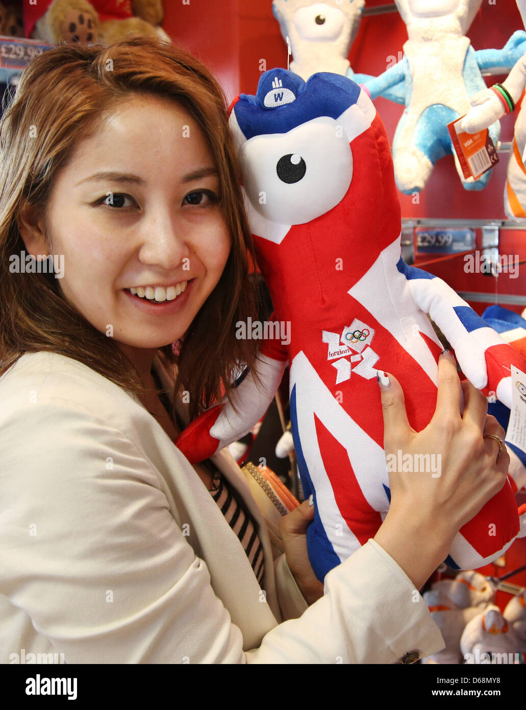 Ryoko Sato hugs the official olympic mascot 'Wenlock' in a souvenir shop in London, Great Britain, 19 July - Stock Image