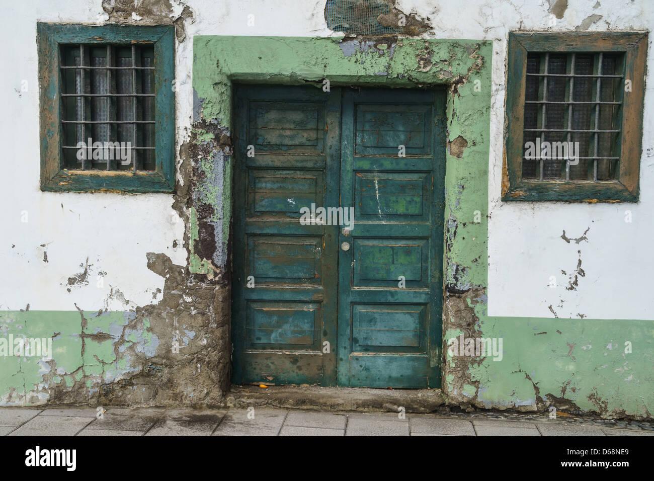 La Palma, Canary Islands - Santa Cruz, island capital. Weather erods old stone and plaster house. - Stock Image