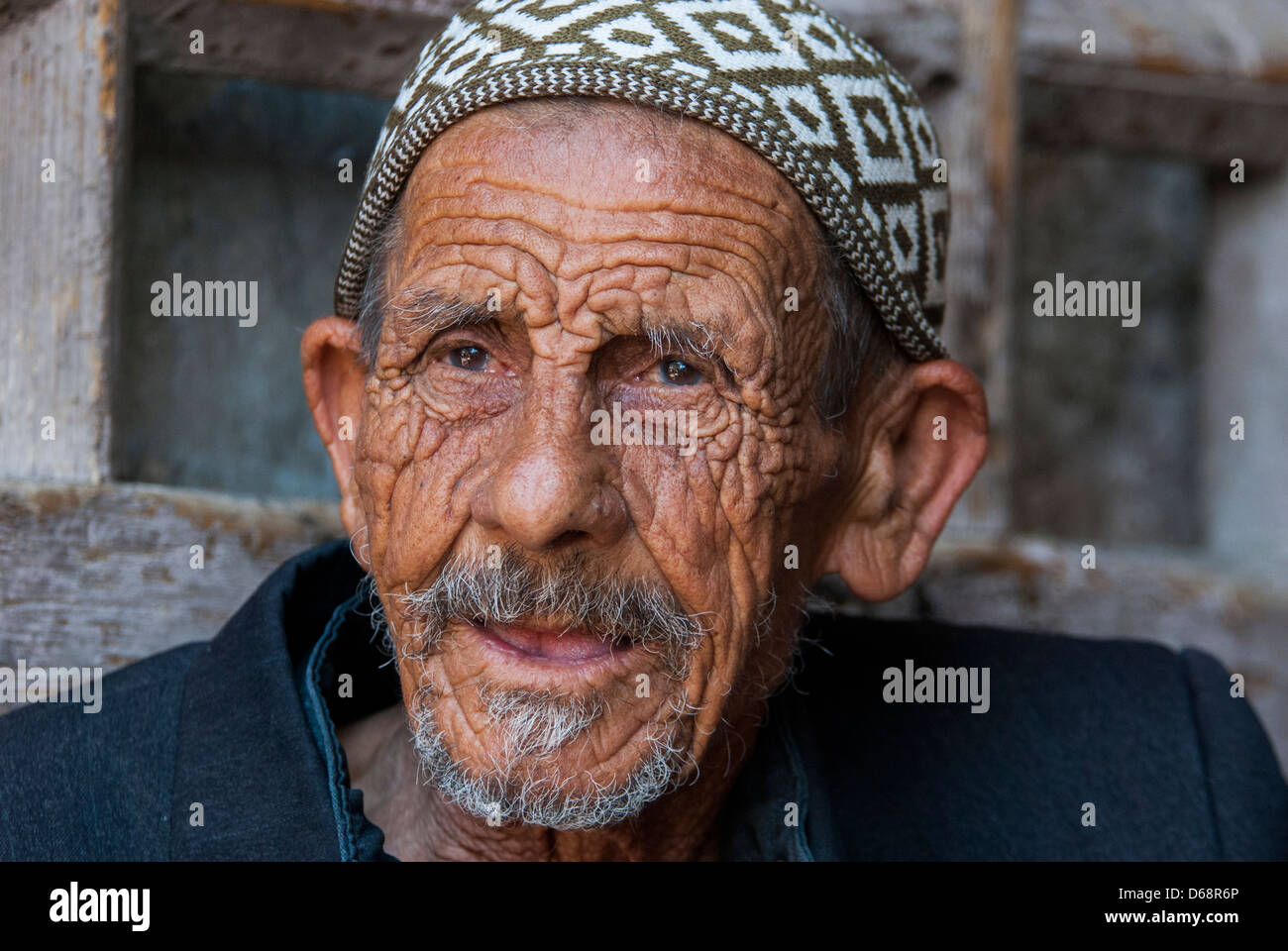 Headshot of a mature Arab man. Photographed in the Old City Jerusalem - Stock Image