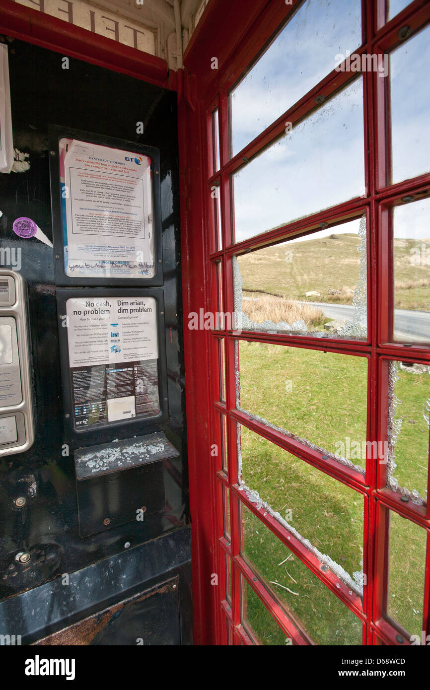 Interior of a remote vandalised K6 red telephone kiosk near Tregarron, Powys, mid Wales - Stock Image