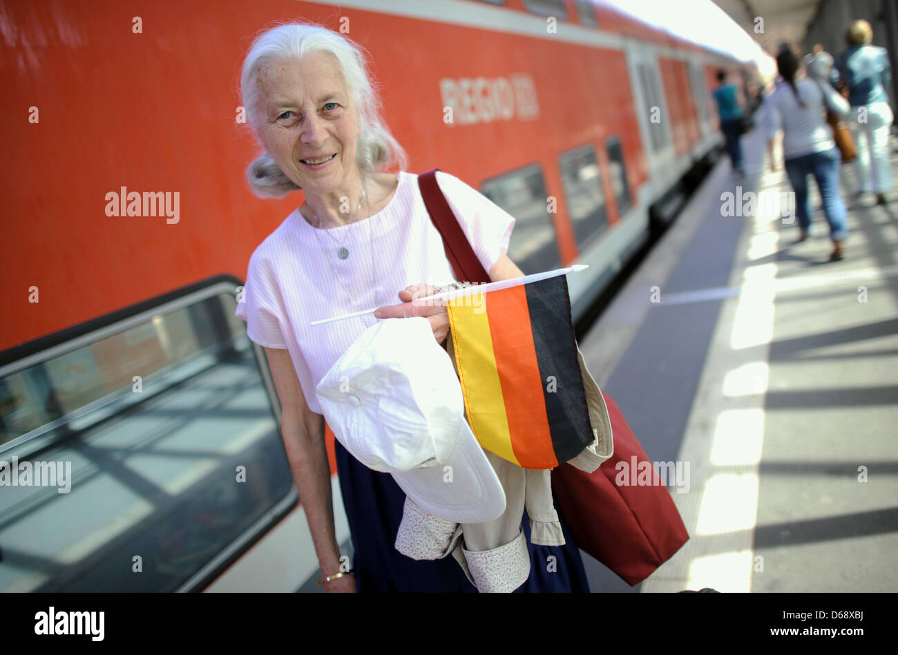 Hannelore Paepcke smiles shortly before her departure for the Olympic Games 2012 in London at the central train - Stock Image
