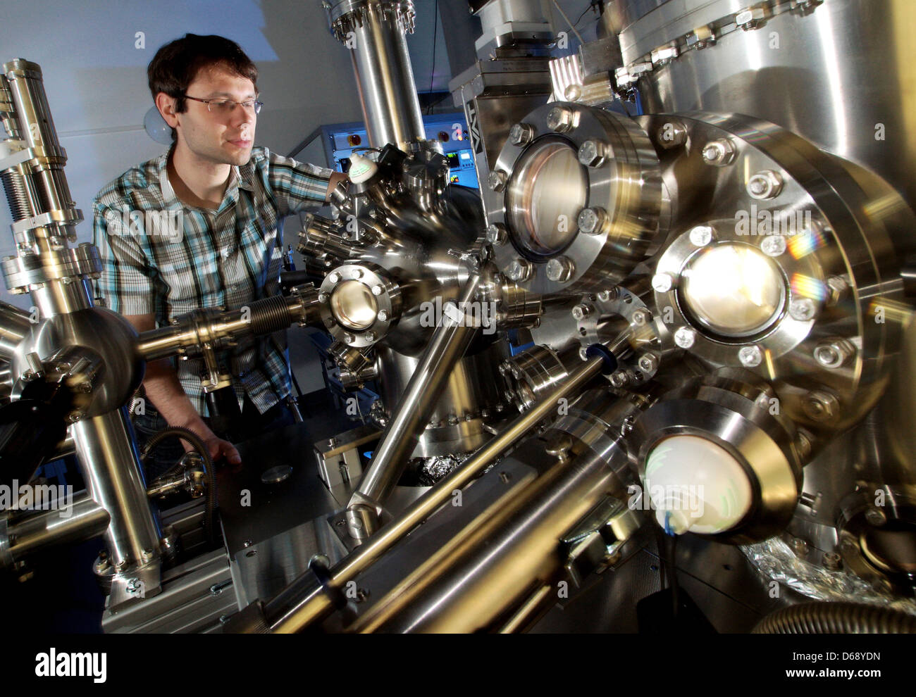 Physicist Dr. Roman Forker works on a modern research device of a completely new developed generation of a device - Stock Image