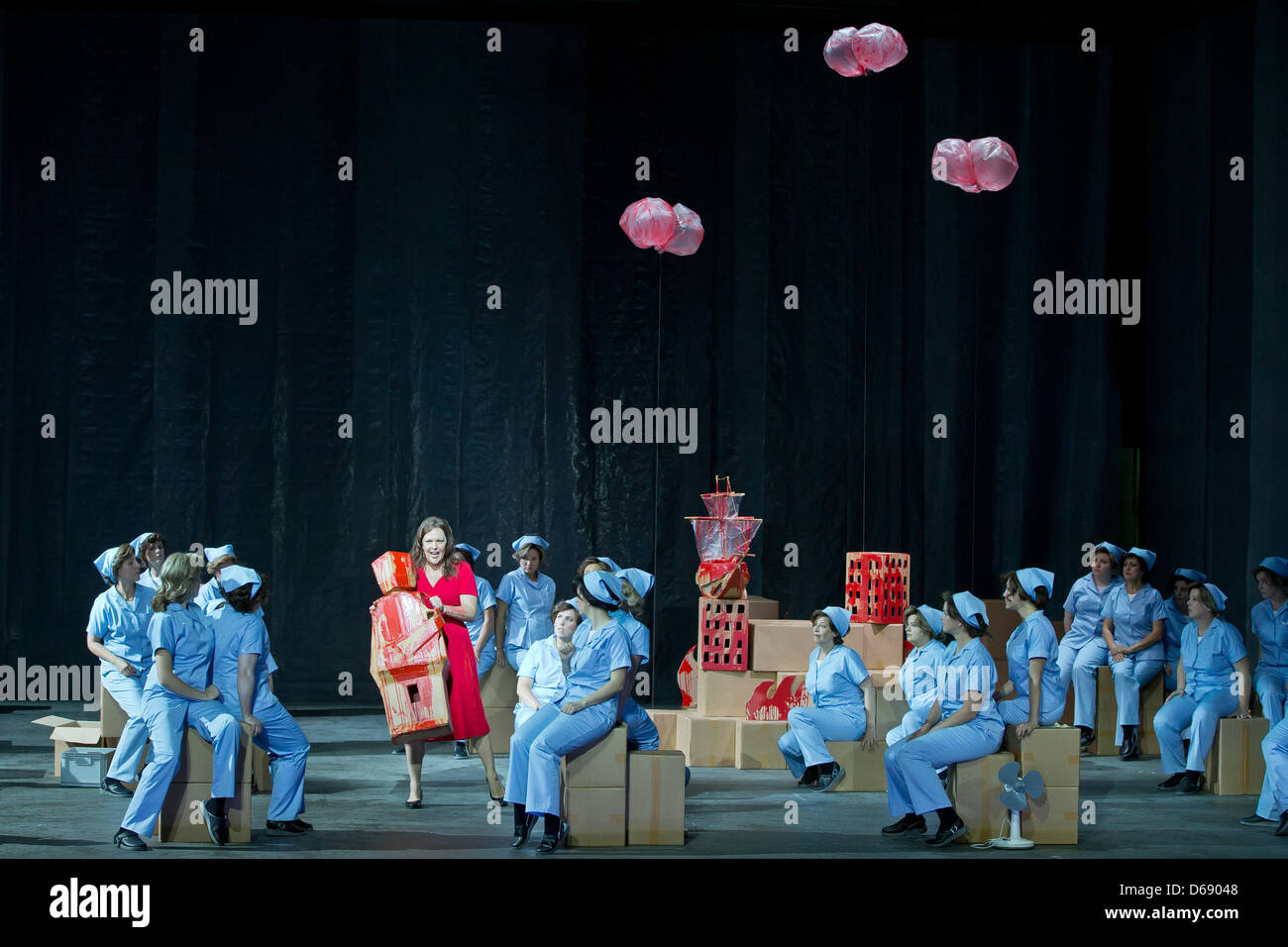 Adrianne Pieczonka (in red dress) as Senta takes part in a dress rehearsal of Wagner's 'The Flying Dutchman' - Stock Image