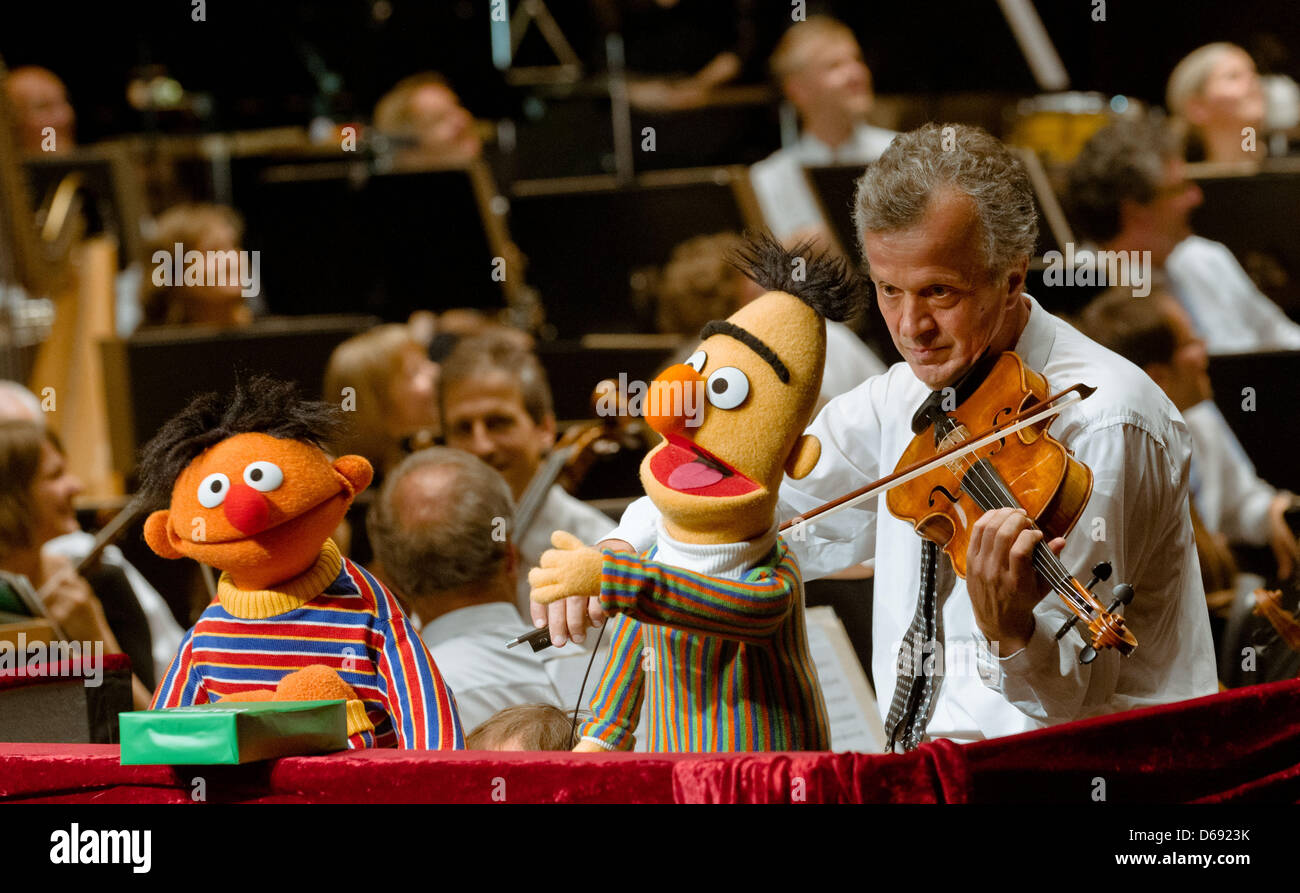 The Sesame Street characters Ernie (L) and Bert take part in a concert at the Schleswig-Holstein Music Festival Stock Photo
