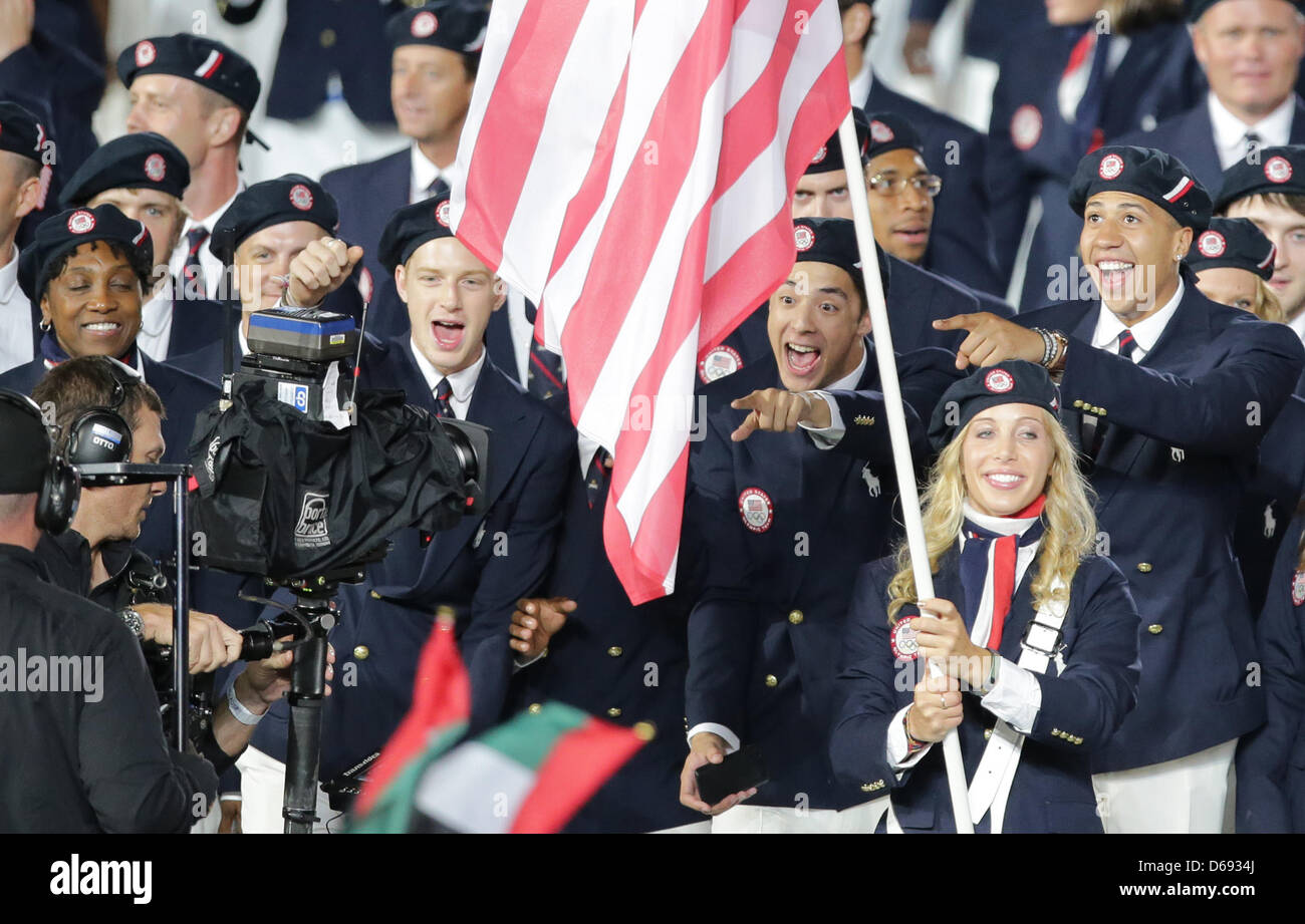Olympic team of USA with flag bearer and fencer Mariel Zagunis arrive into the Olympic stadium during the Opening Stock Photo