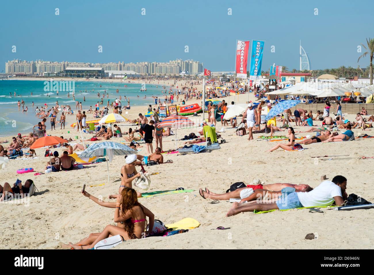 Busy beach near Marina at New Dubai in United Arab Emirates - Stock Image