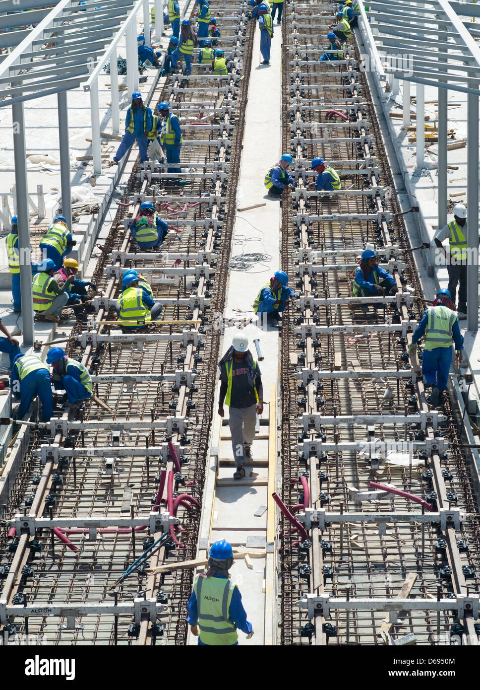 Construction workers laying railway tracks for  new Al Sufouh Tramway in Dubai United Arab Emirates - Stock Image
