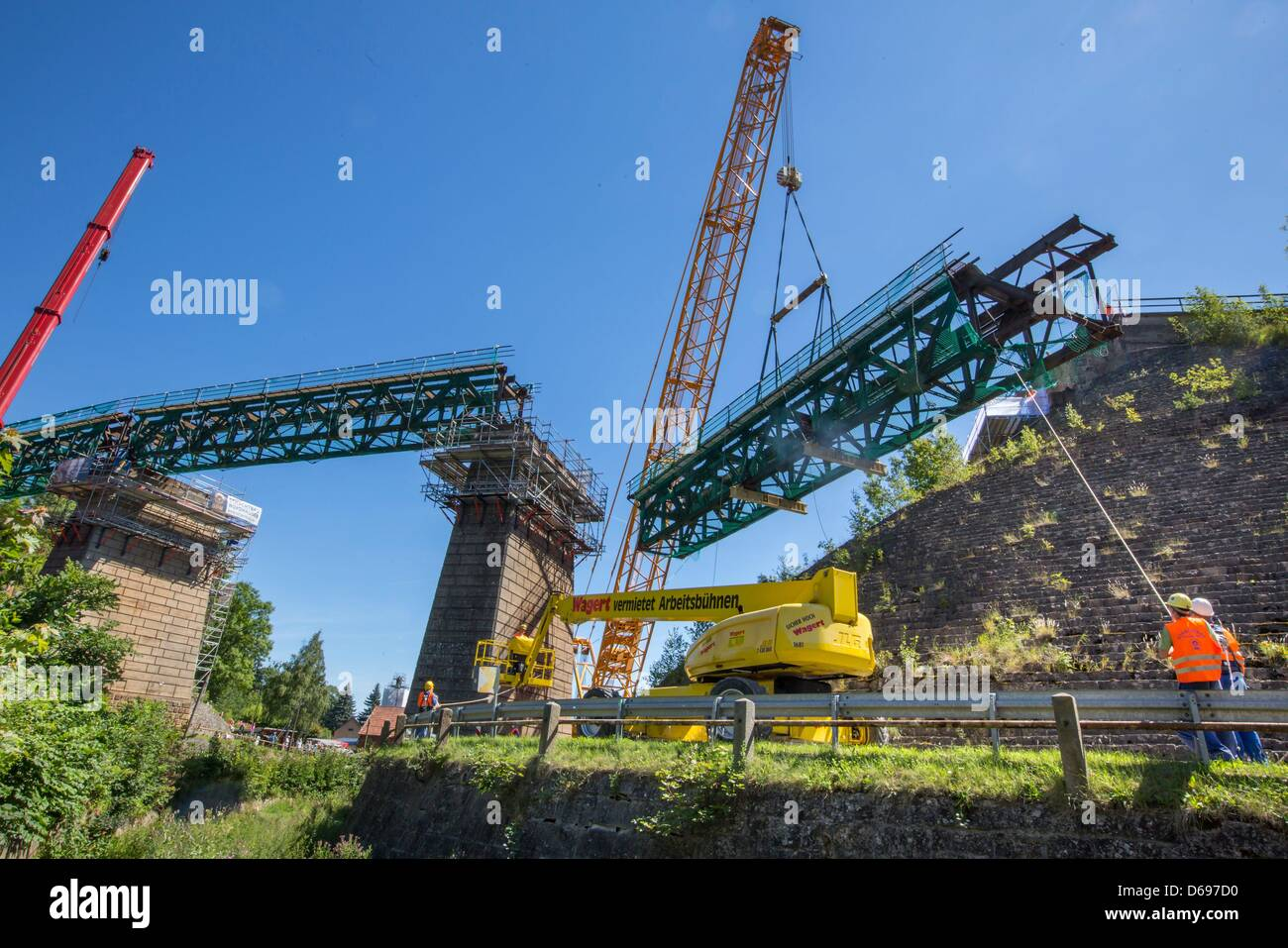 A big crane lifts an 80 t-part of the railway viaduct in Angelroda, Germany, 28 June 2012. It is the first of three - Stock Image