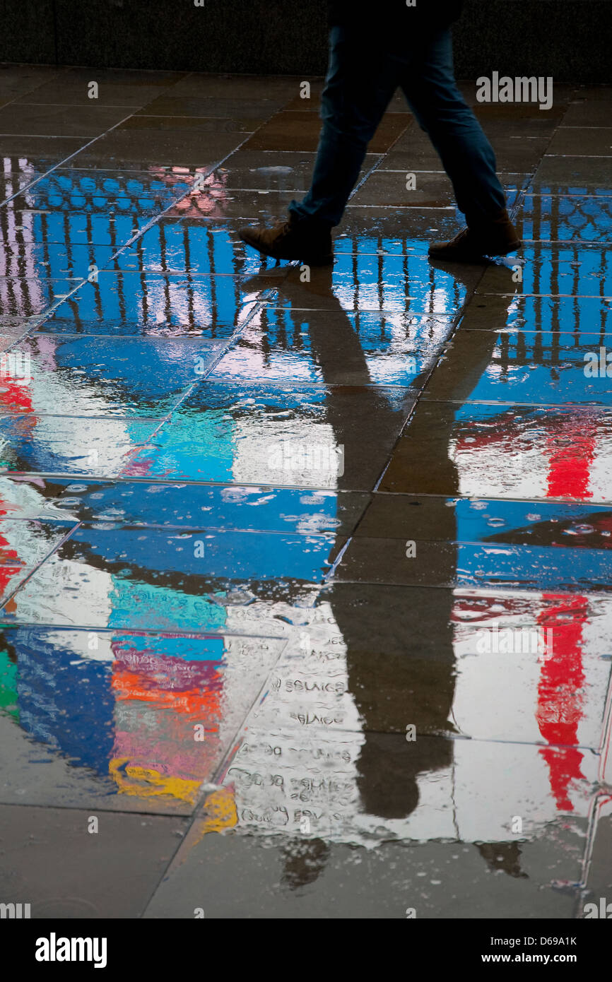 neon sign reflections on wet pavement, piccadilly circus, london, england - Stock Image