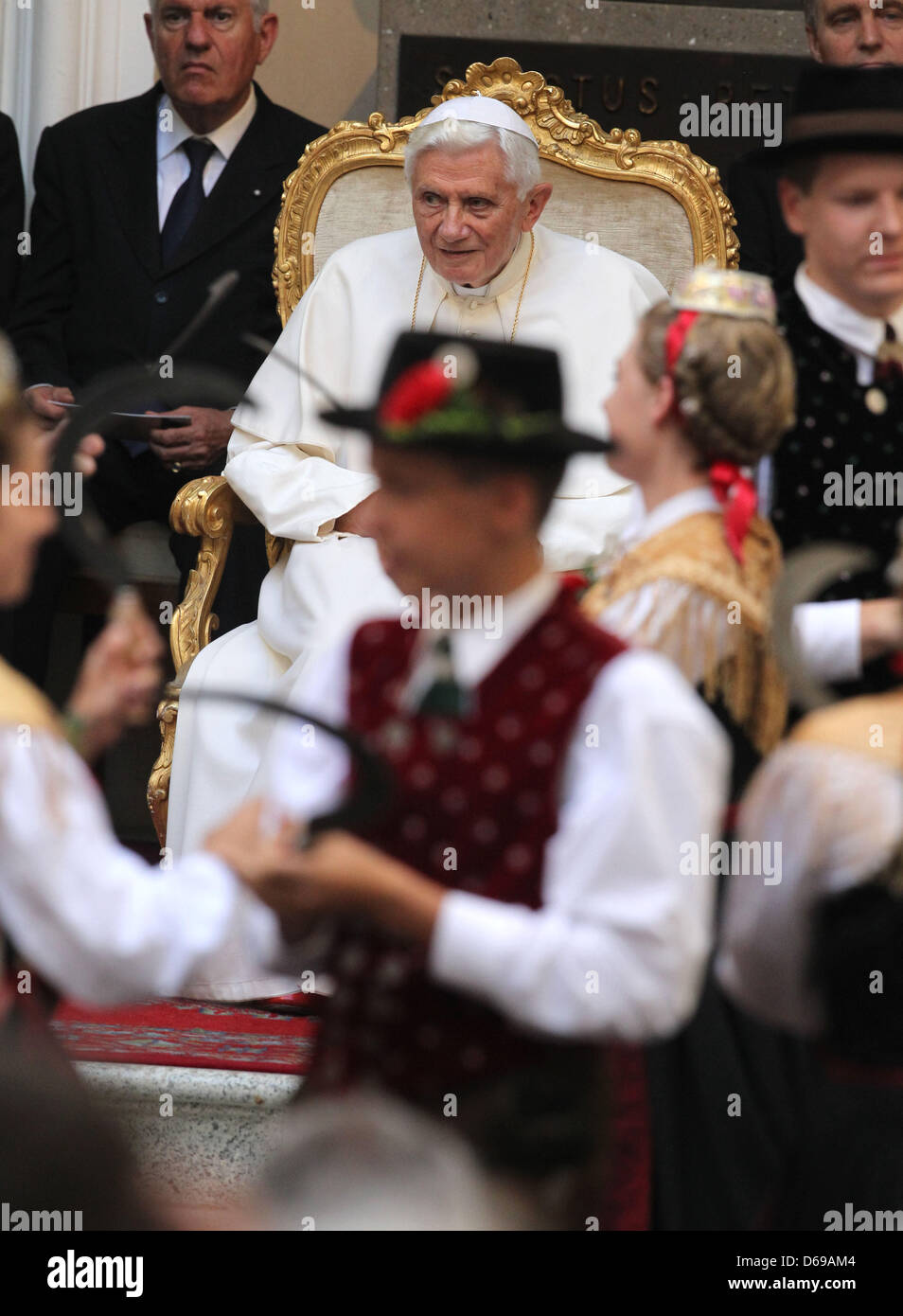Bavarian pilkgrims wearing their traditional costumes perform a harvest dance for Pope Benedict XVI at the Papal - Stock Image