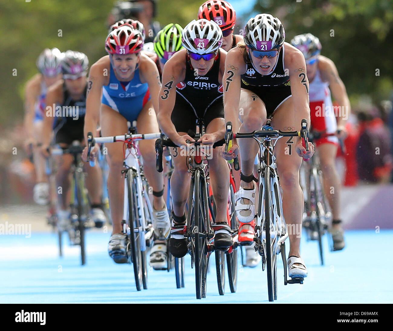 Germany's Svenja Bazlen (R) and Switzerland's Nicola Spirig (C) compete in the Women's Triathlon during - Stock Image