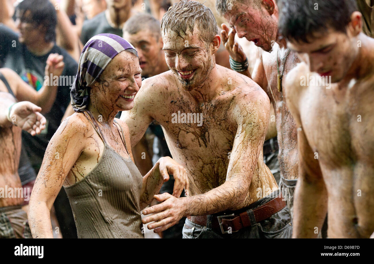 Festival visitors celebrate in the mud in front of the main stage at the music festival 'Woodstock Station' - Stock Image