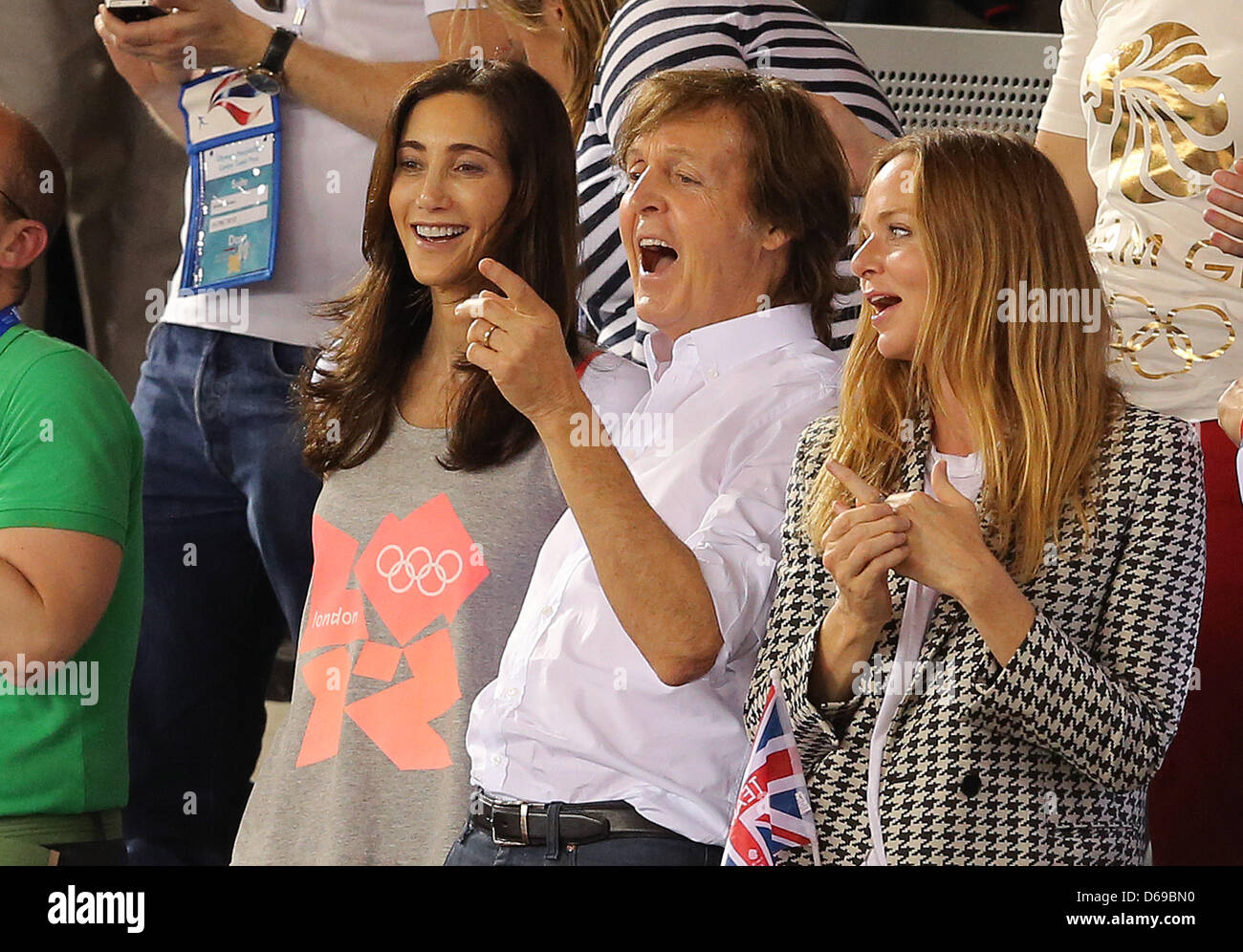 Sir Paul McCartney C His Wife Nancy Shevell L And Daughter Fashion Designer Stella R Are Attending The Cycling Event At Veldorome
