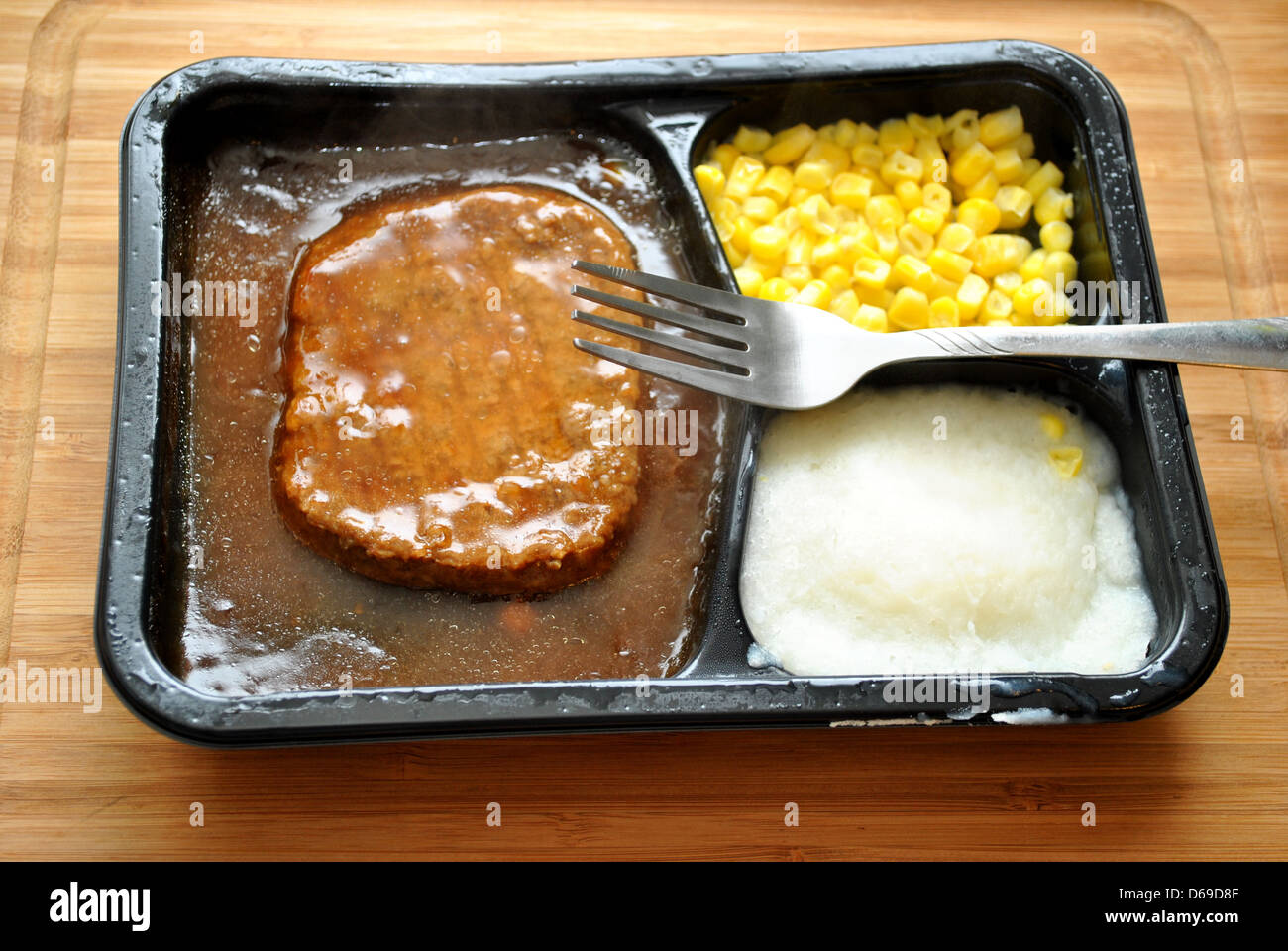 Salisbury Steak TV Dinner with a Fork - Stock Image