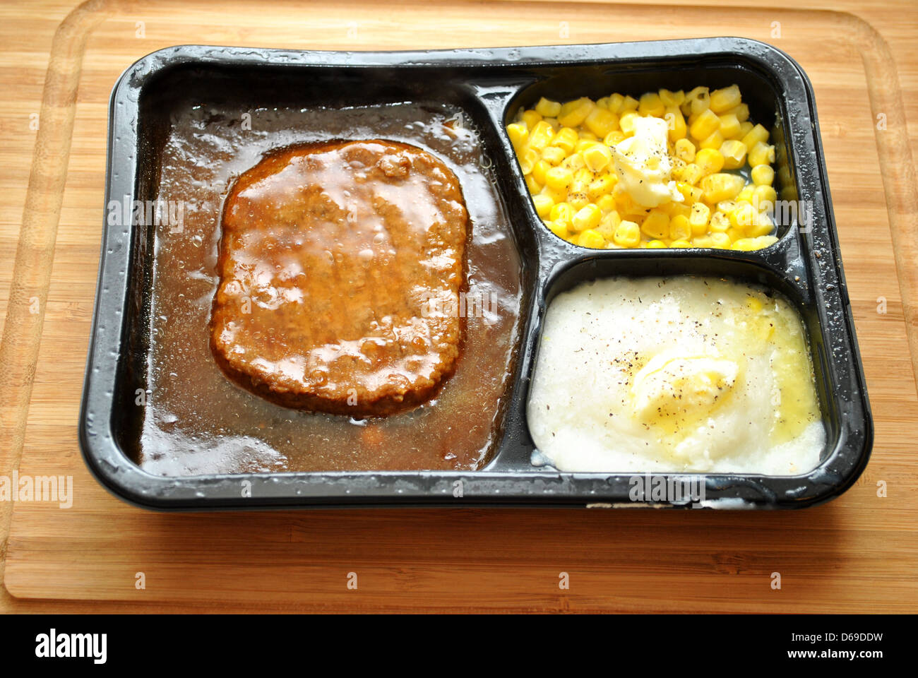 Tasty TV Dinner with Pepper and Butter Added - Stock Image