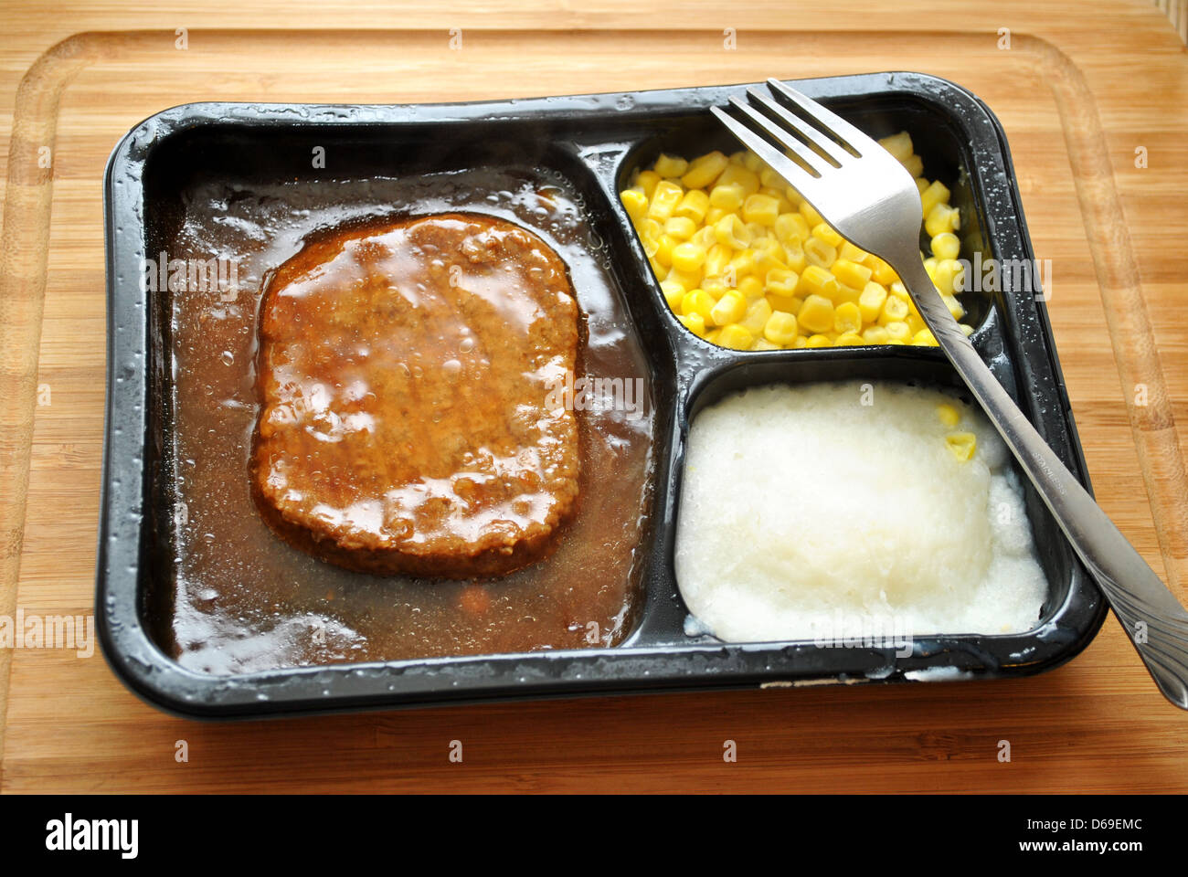 Quick Meal of a TV Dinner with a Fork - Stock Image