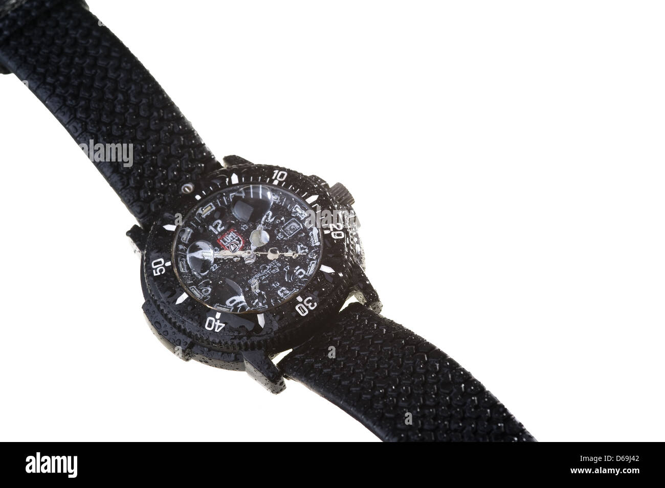 A waterproof wristwatch with water droplets of water - Stock Image