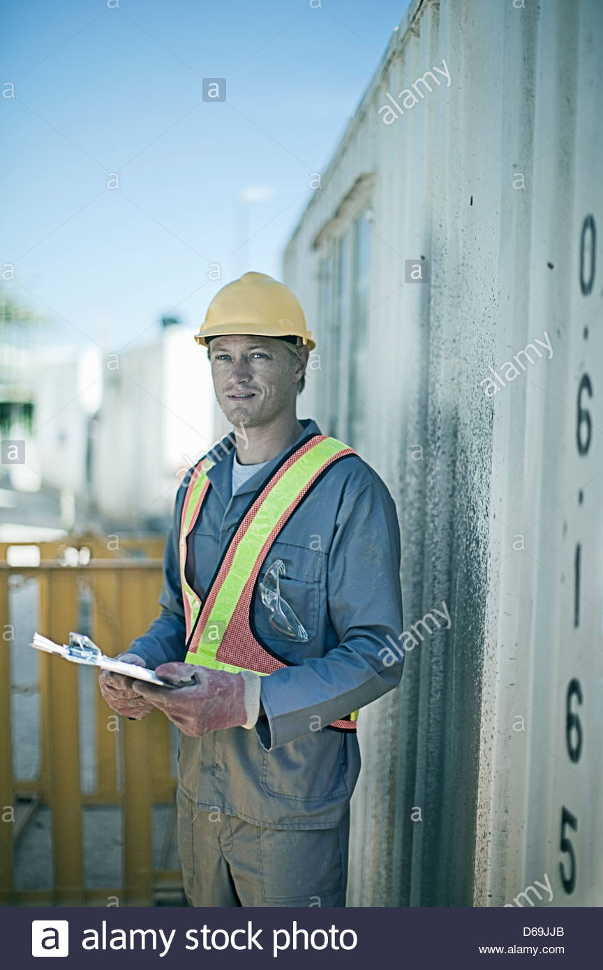 Construction worker standing on site - Stock Image