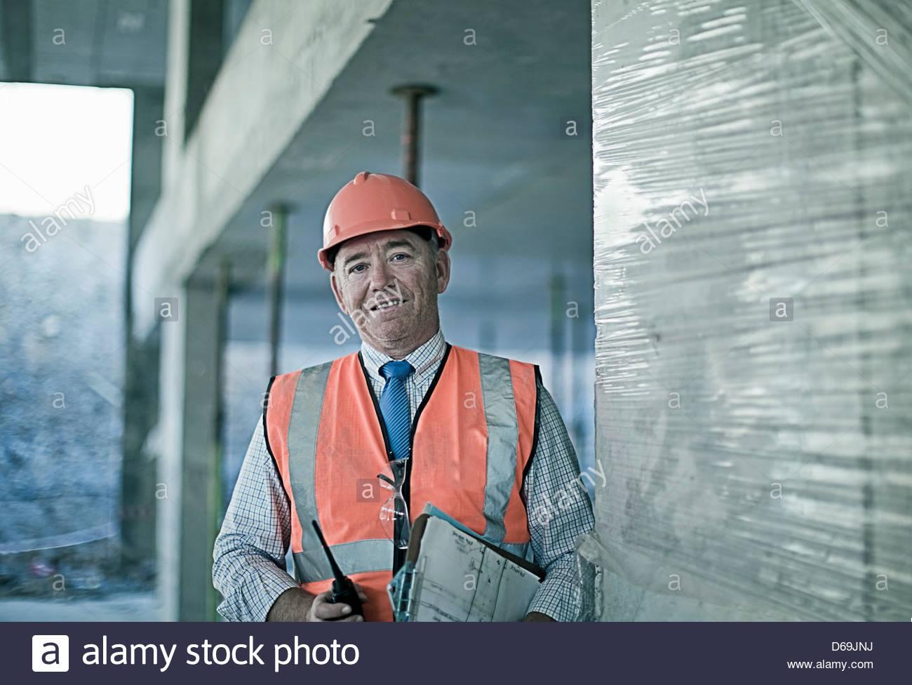 Businessman on construction site - Stock Image