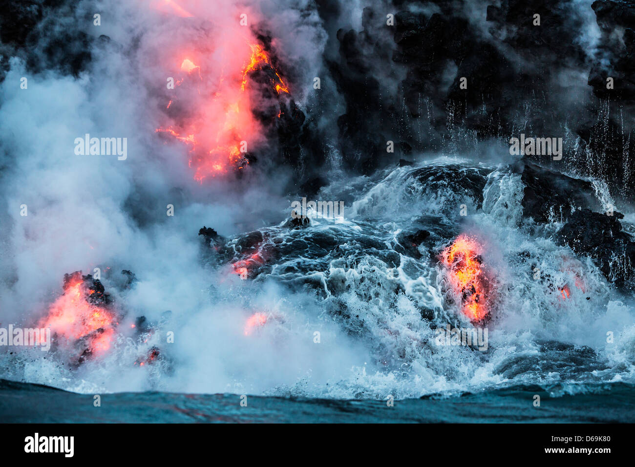 Lava flowing into water - Stock Image