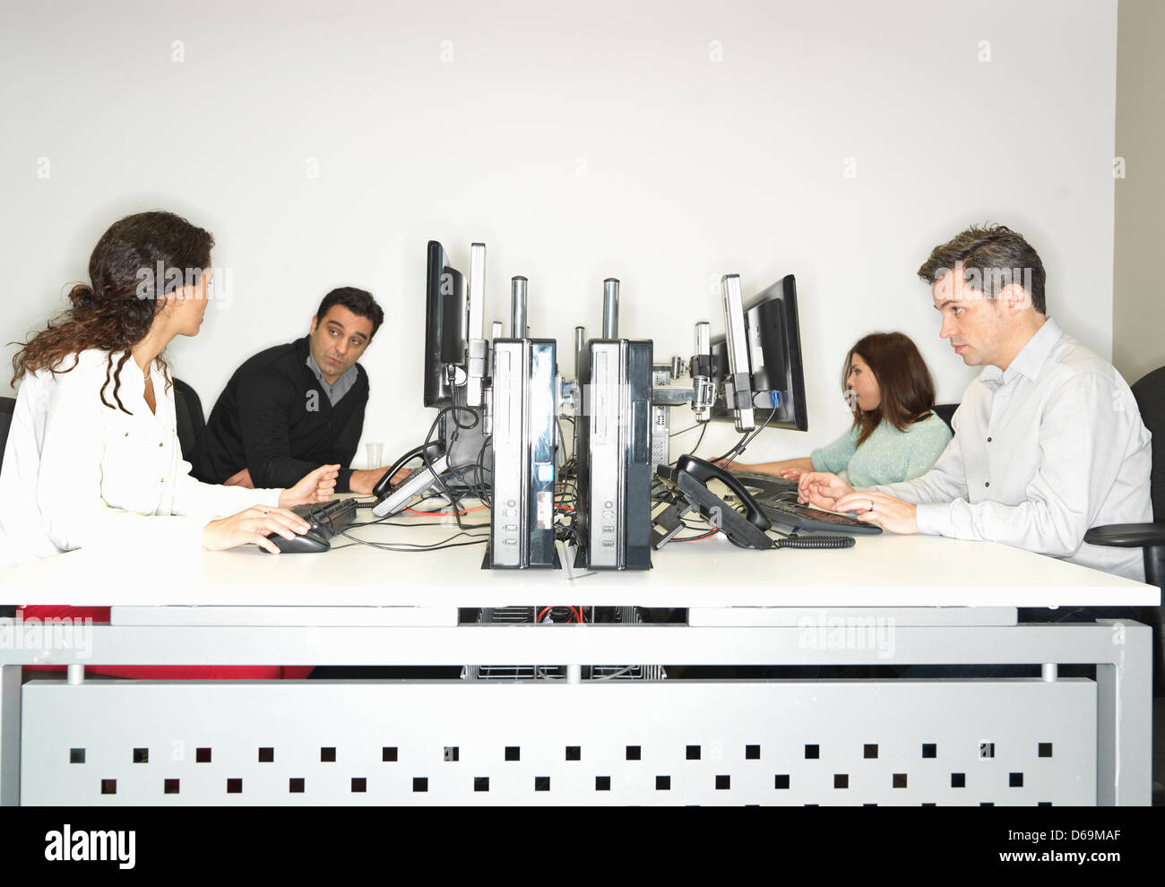 Business people working at desk - Stock Image