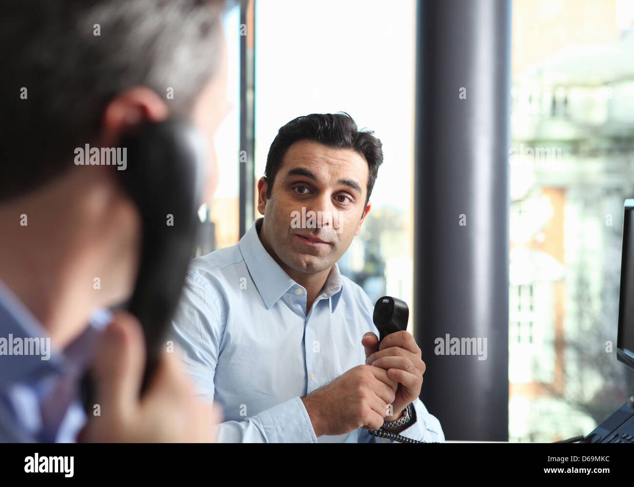 Businessmen talking on cell phones - Stock Image