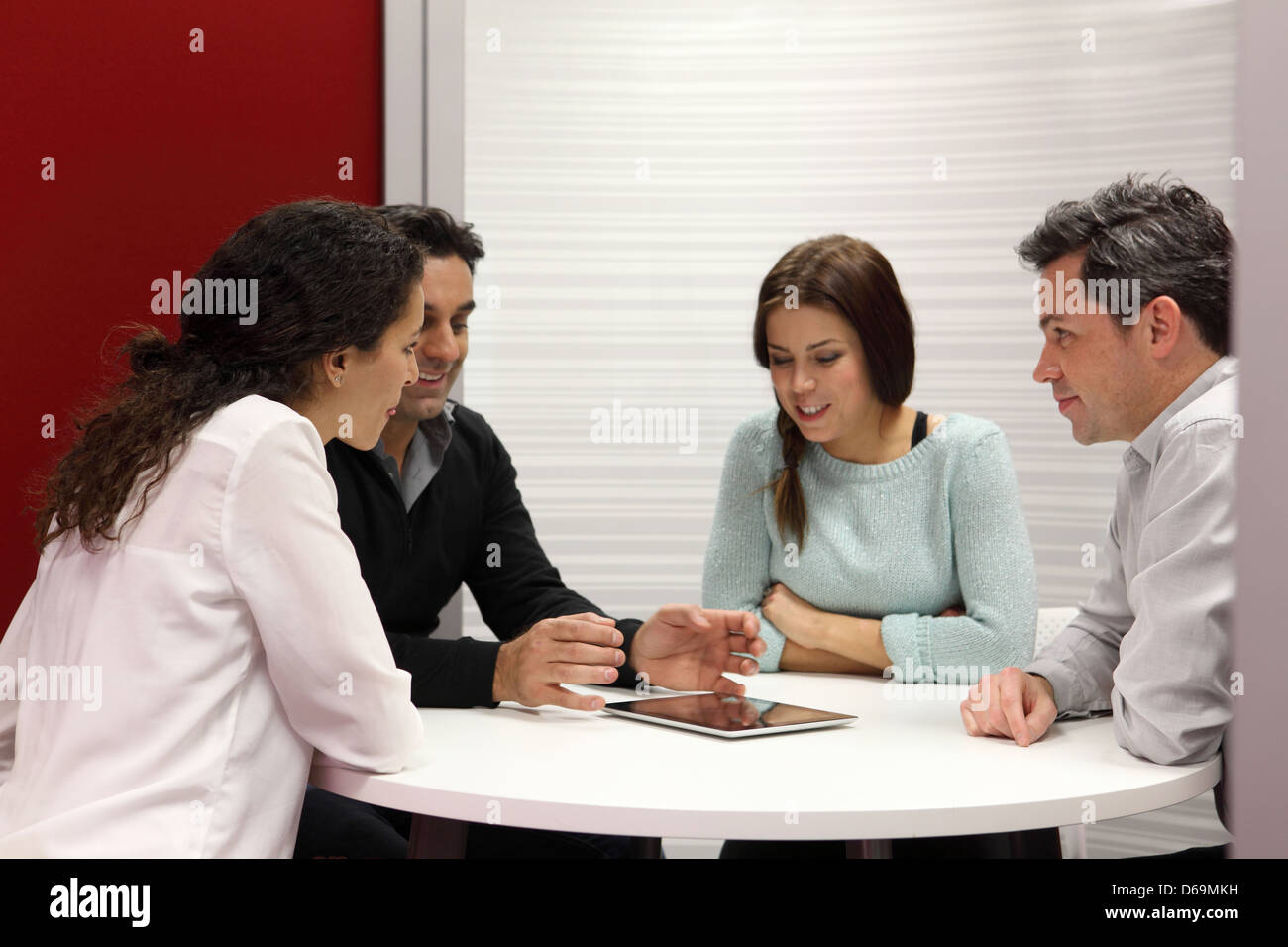 Business people using tablet computer - Stock Image