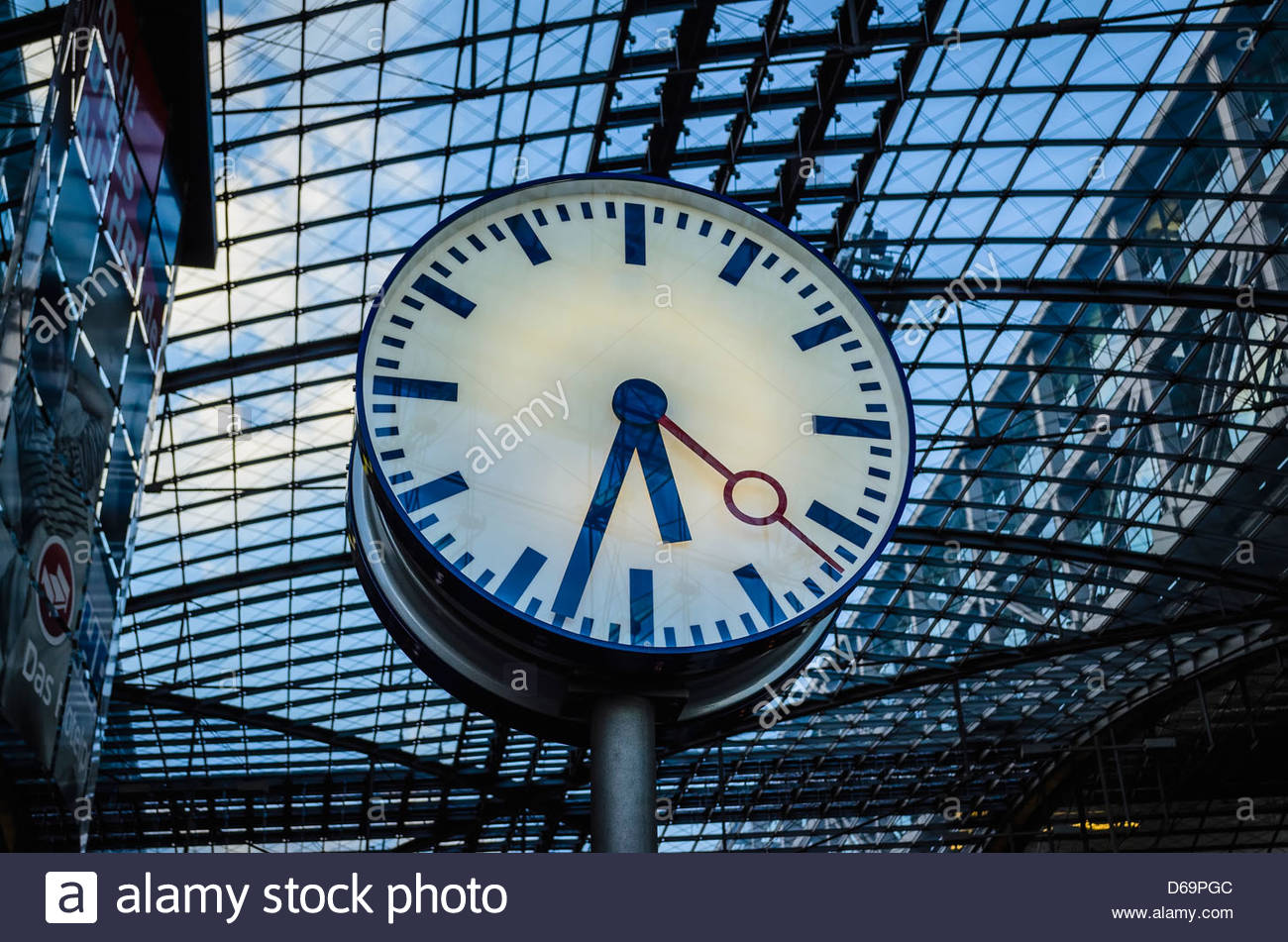 Clock in train station - Stock Image