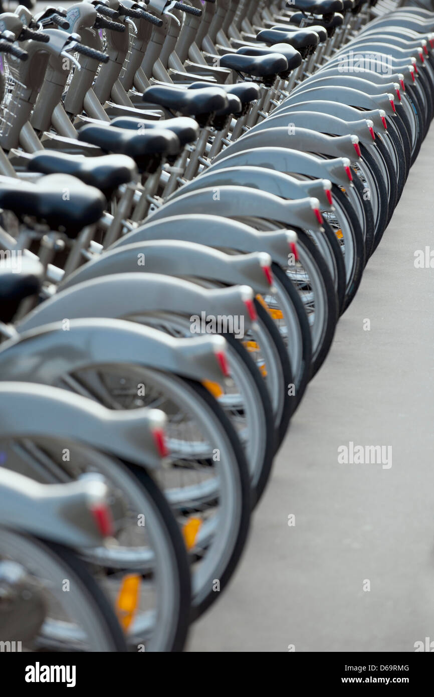 Bicycled parked in row on city street - Stock Image