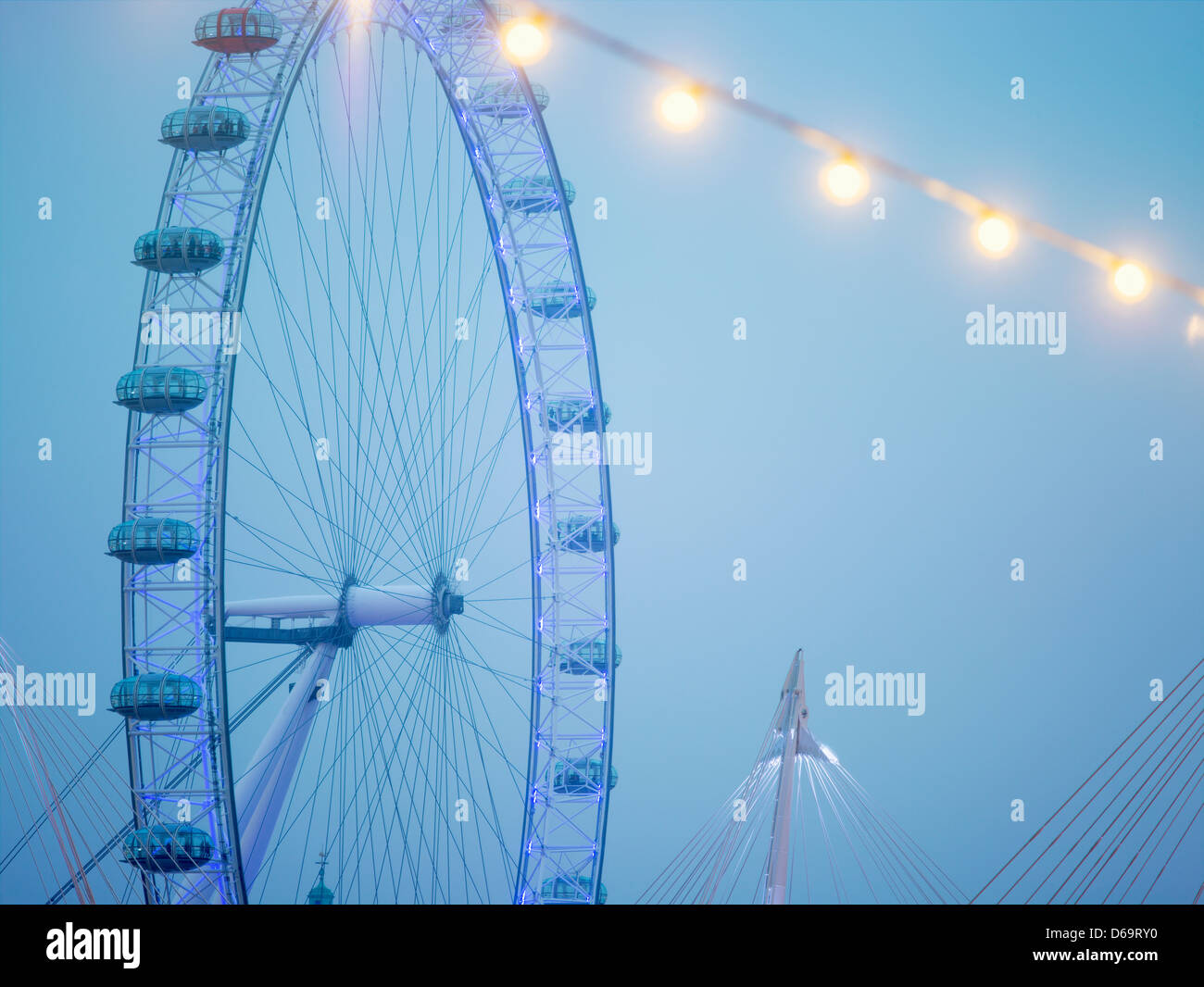 London Eye ferris wheel in blue sky - Stock Image