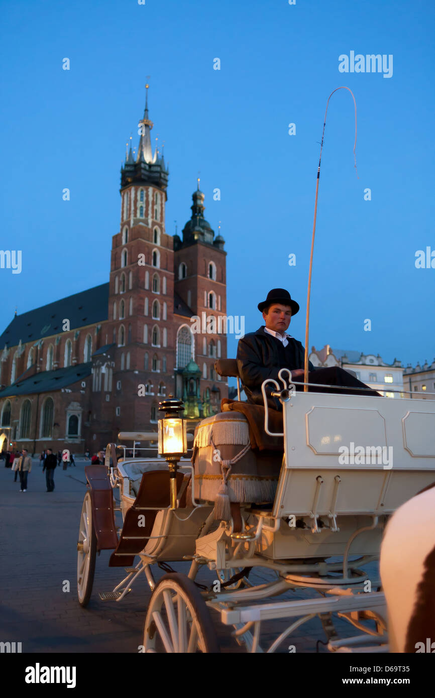 Krakow, Poland, coachman for tourists in front of St. Mary's Church - Stock Image