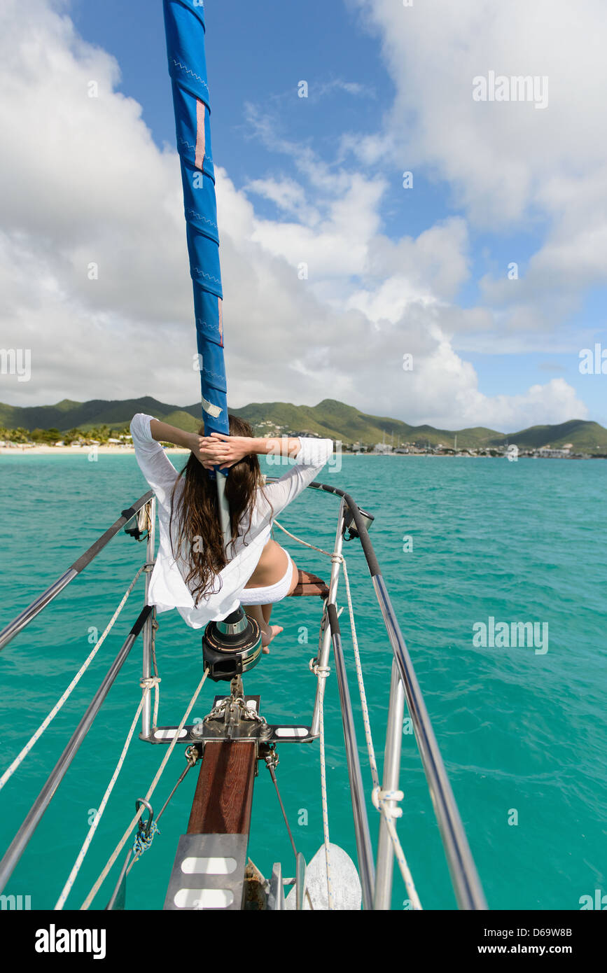 Woman relaxing on boat - Stock Image