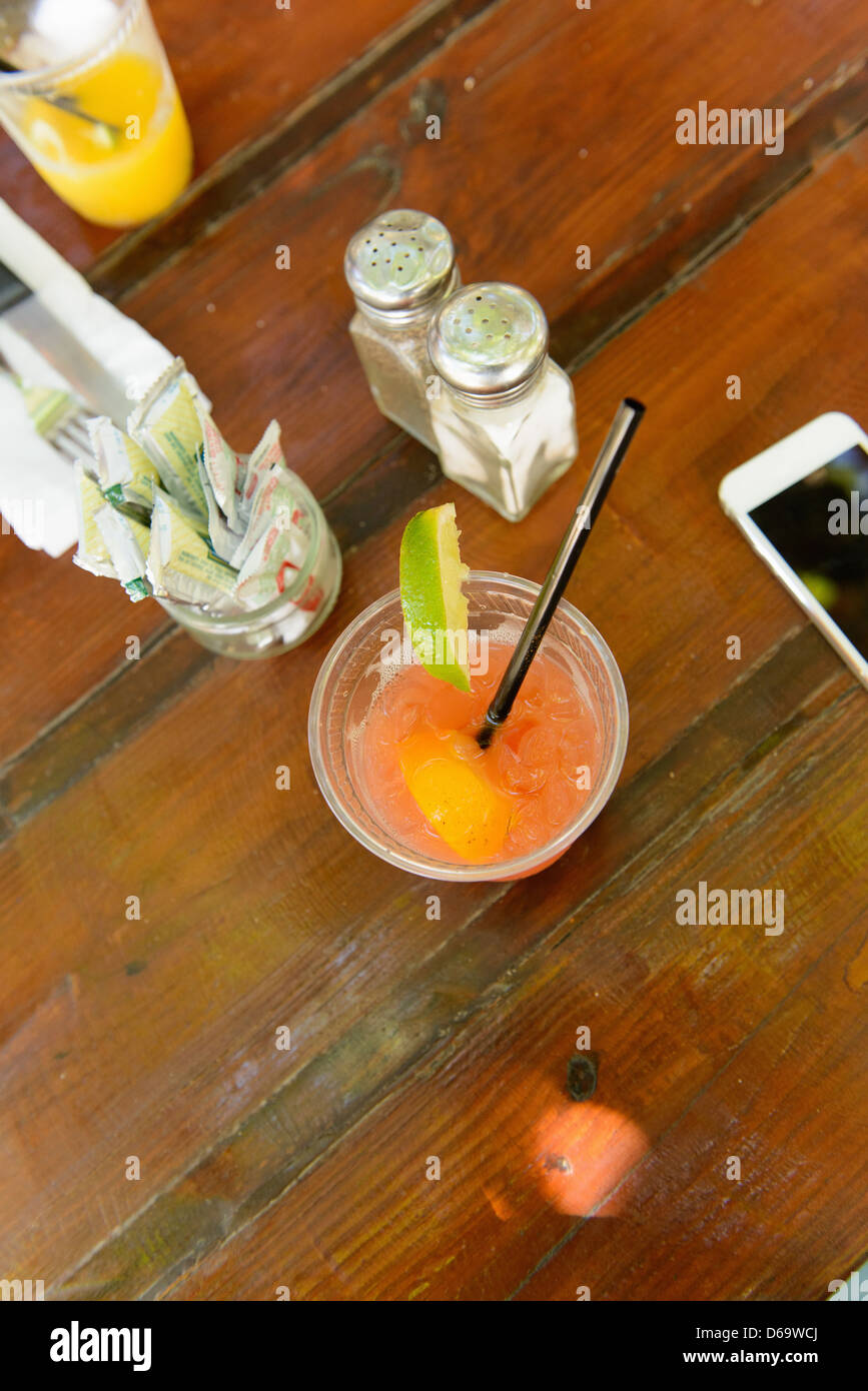 Close up of fruity cocktail at restaurant - Stock Image