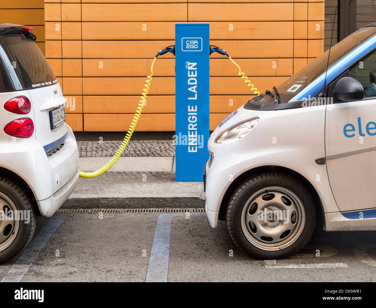 Electric cars charging at a re-fuelling point - Potsdamerplatz, Berlin Stock Photo