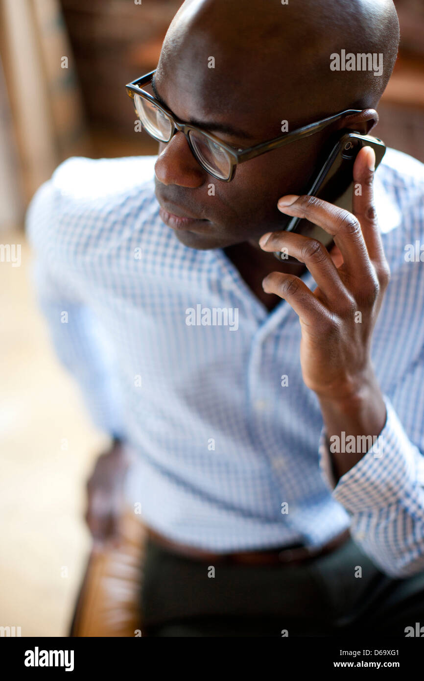 Businessman talking on cell phone Stock Photo