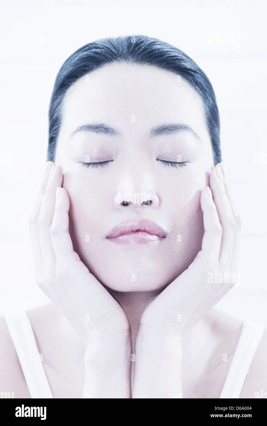 Close up of woman cupping her chin Stock Photo