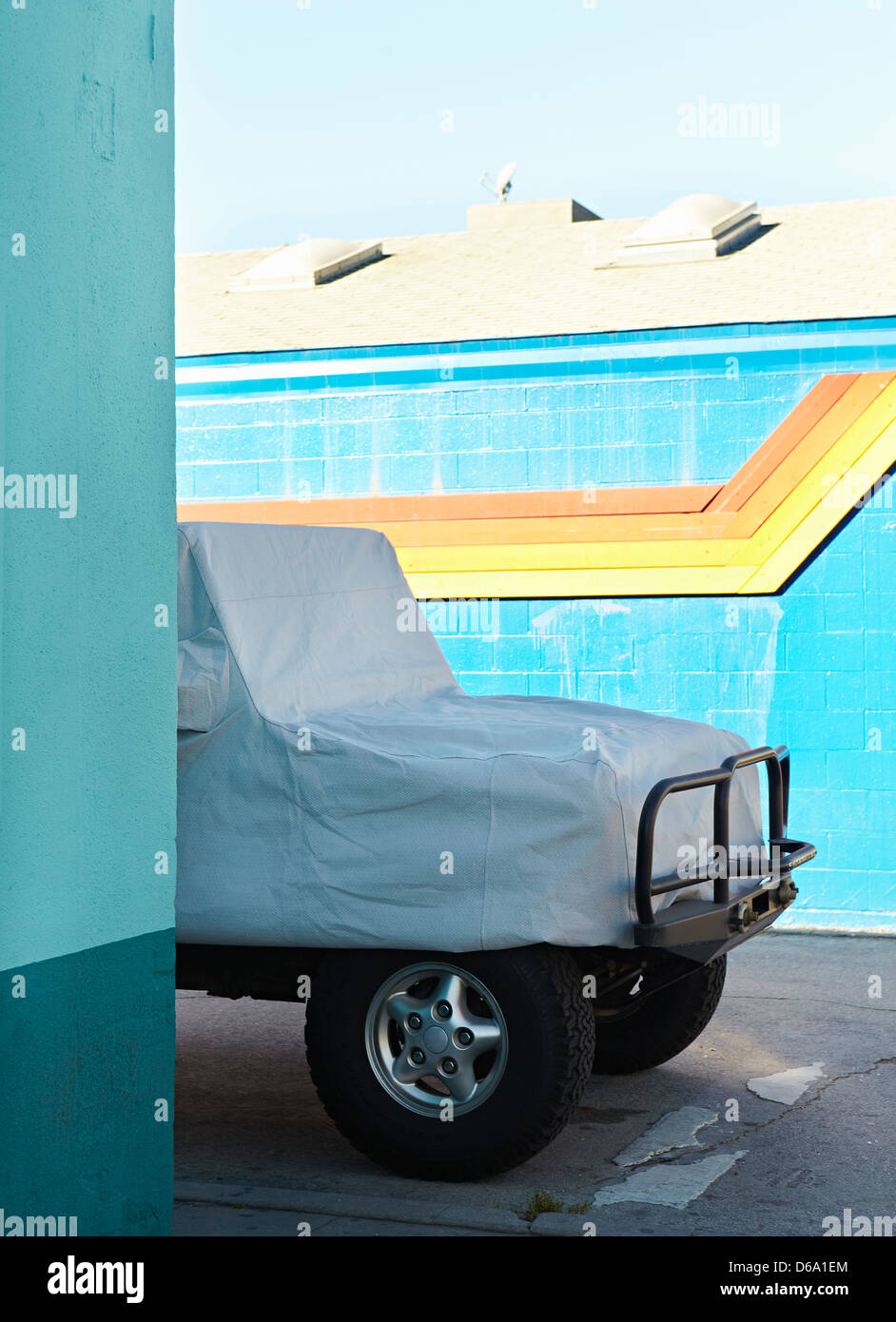 Jeep parked with protective cover - Stock Image