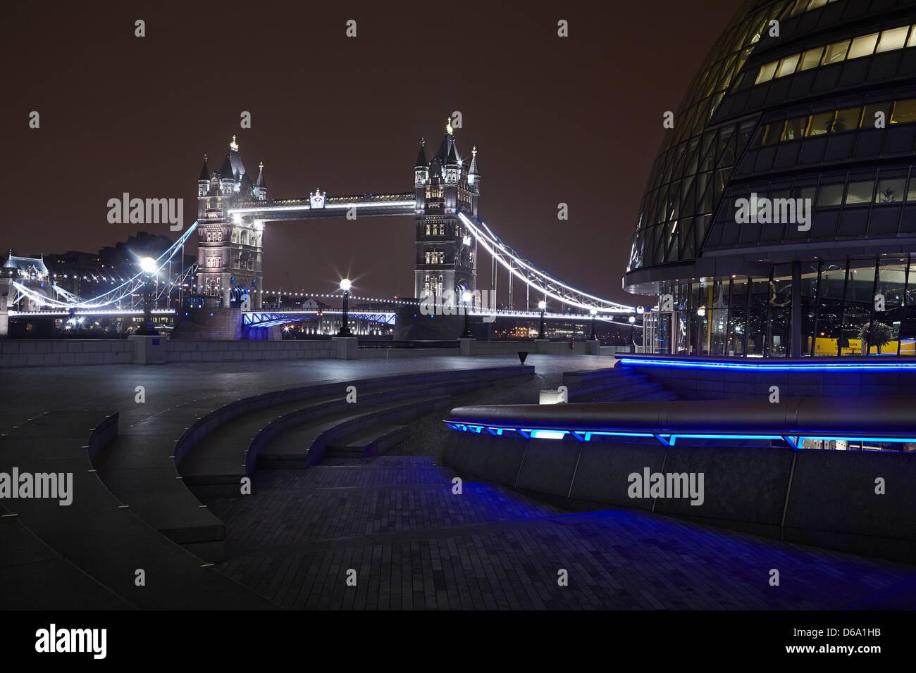 Urban bridge lit up at night - Stock Image