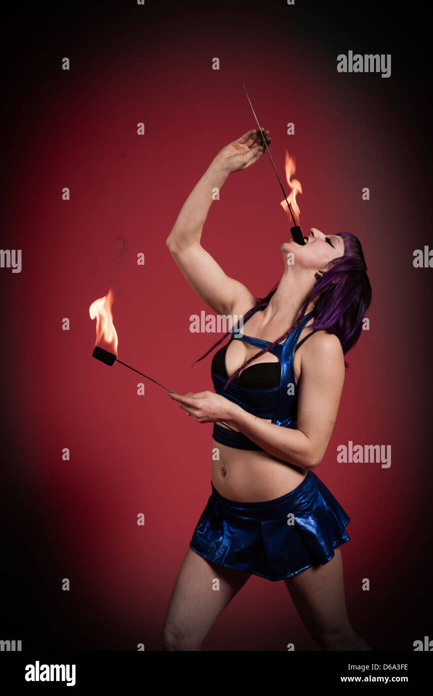 Fire eater performing - Stock Image