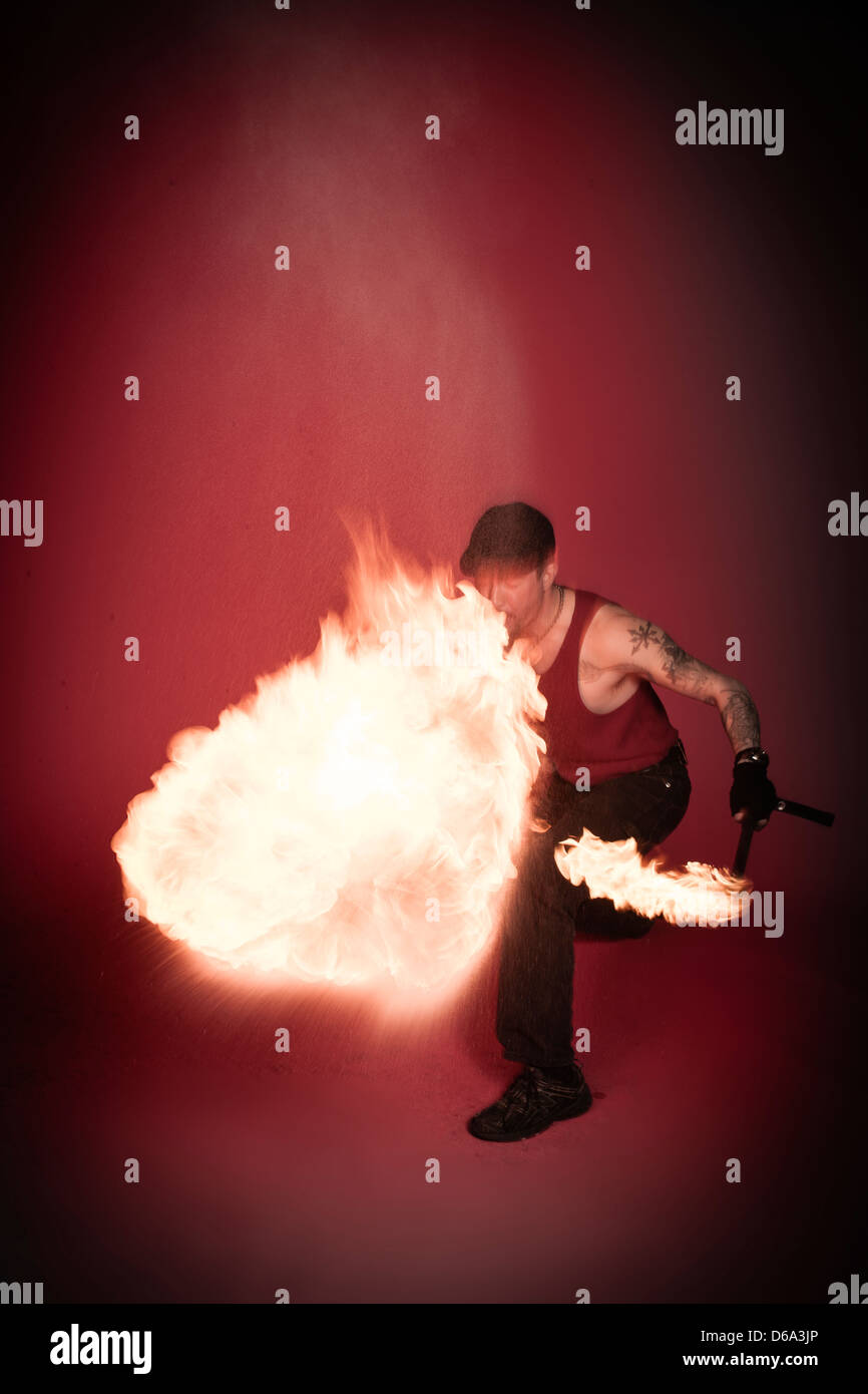 Fire breather performing - Stock Image