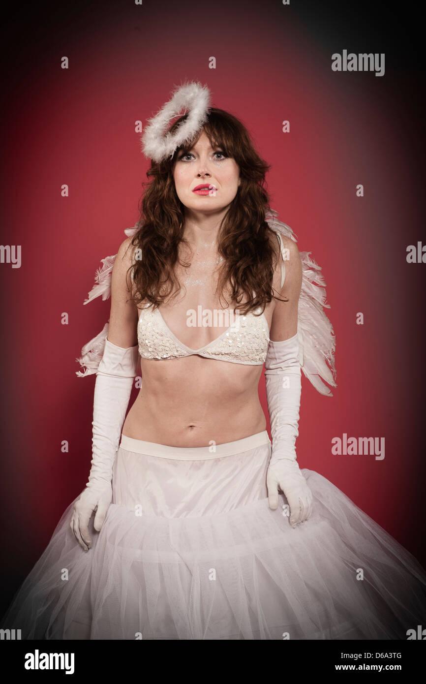 Woman wearing angel costume - Stock Image