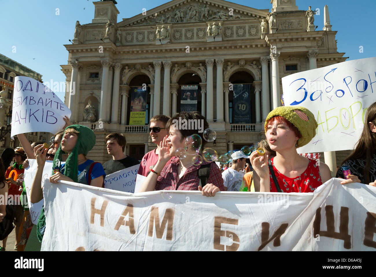 Lviv, Ukraine, young people satirize with absurd nonsense slogans policy - Stock Image