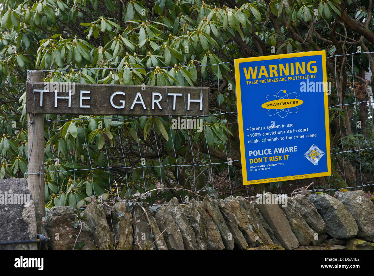 House with sign warning that the contents are protected by Smartwater technology, Bowness, South Lakeland, Cumbria, - Stock Image