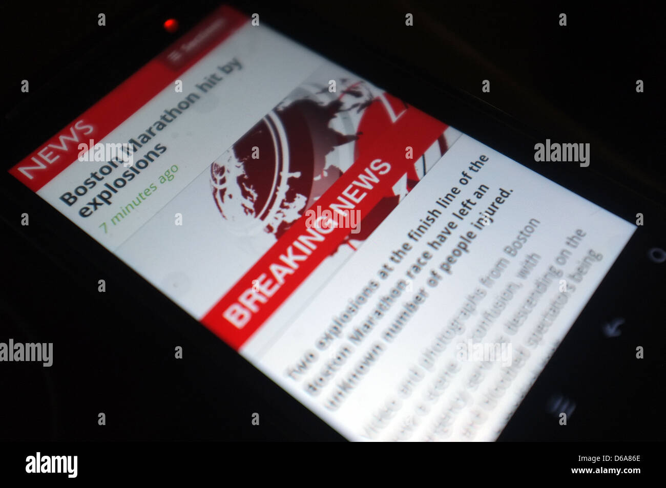 A mobile phone screen showing the tweets following the explosions that hit the Boston Marathon on the 15th April Stock Photo