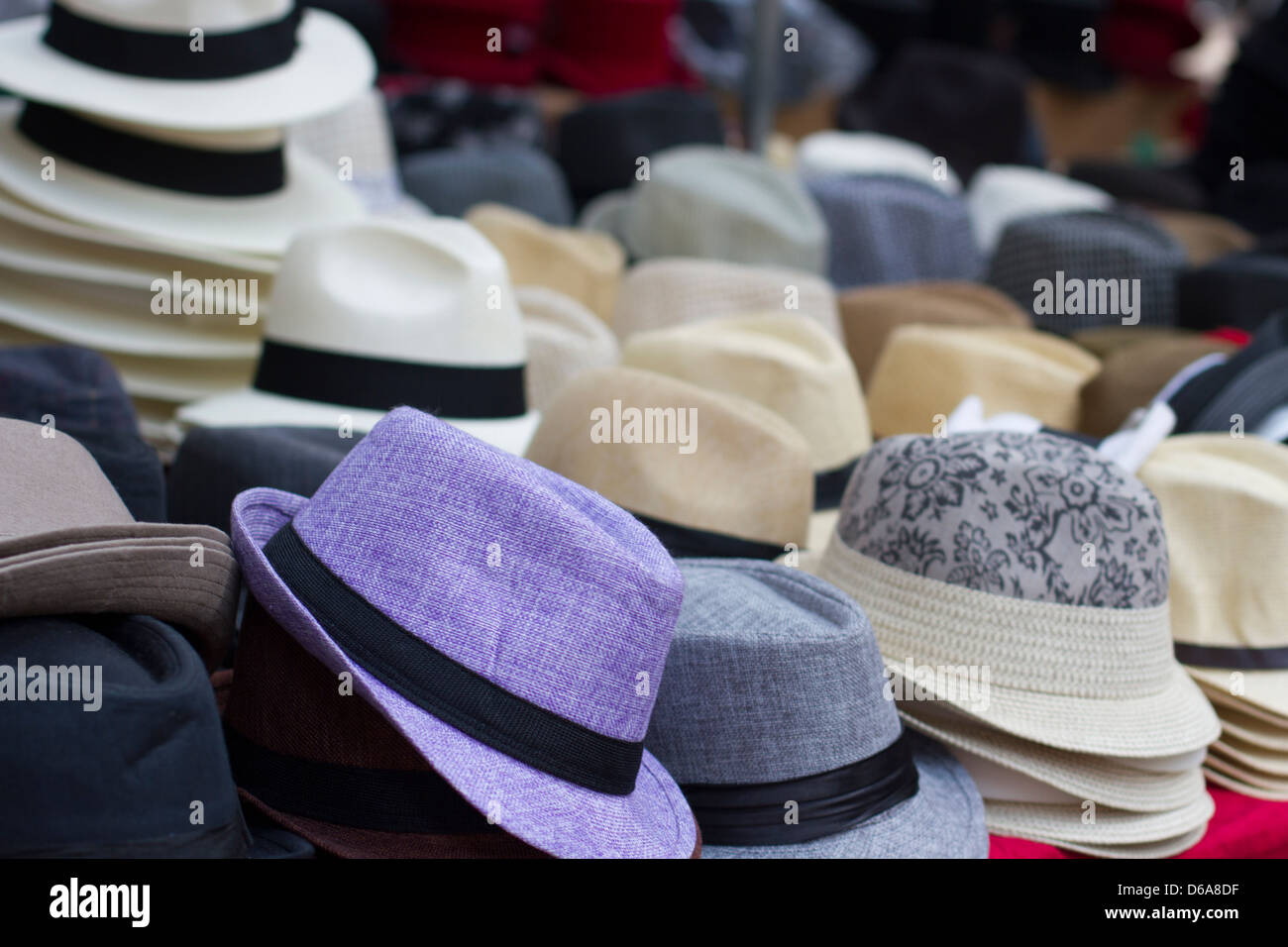 Hats for sale at a market - Stock Image