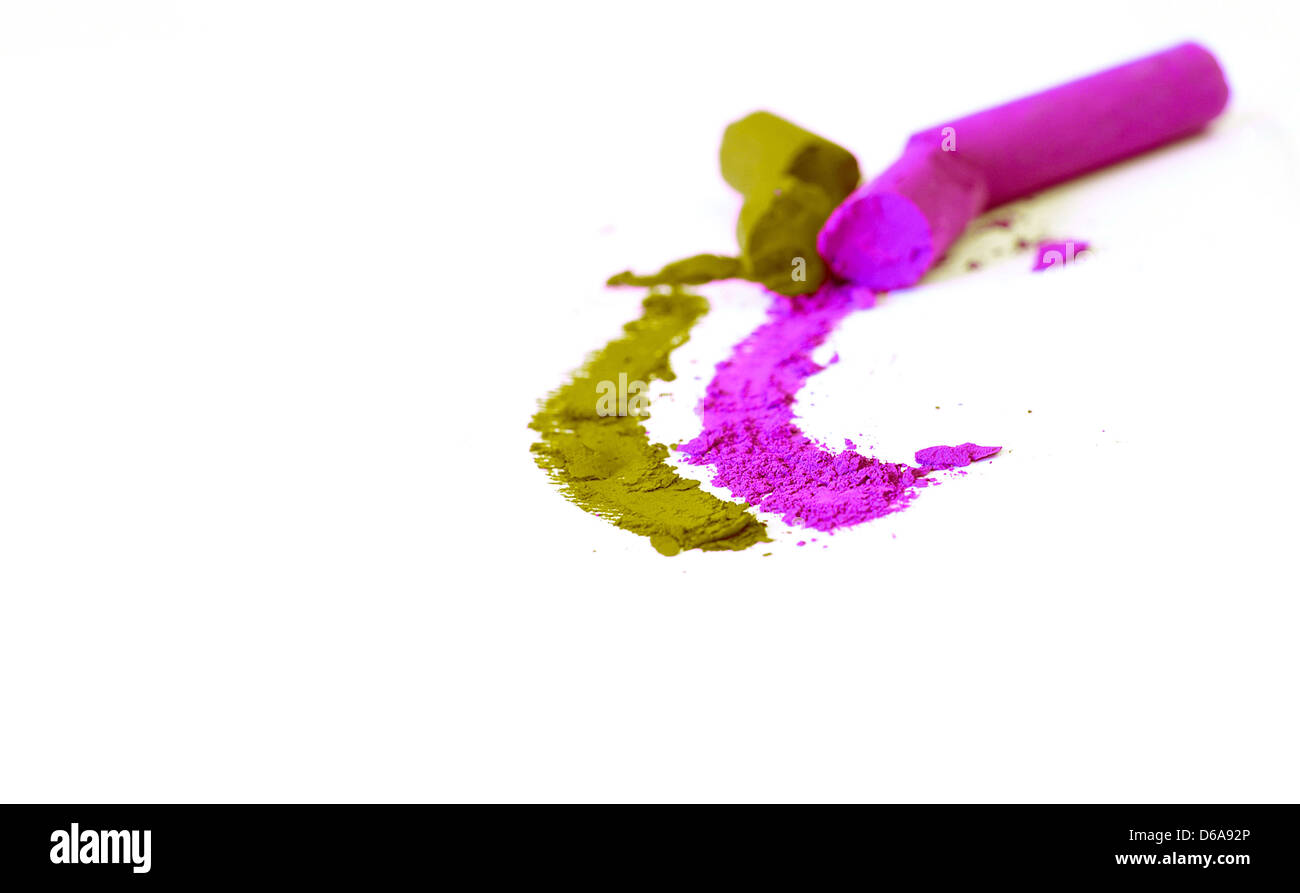 ressed colored chalk on white paper - Stock Image